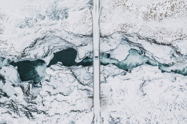 mooie luchtfoto van koluglufur waterval in de winter - vanuit een drone gezien stockfoto's en -beelden