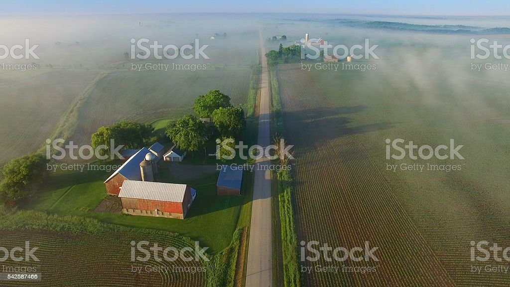 Scenic aerial view of rural Wisconsin on foggy spring morning. stock photo