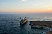 Scenic aerial view of sunk ship on seaside of Cyprus  at sunset