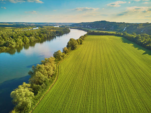 Scenic aerial view of the Seine river and green fields in French countryside stock photo