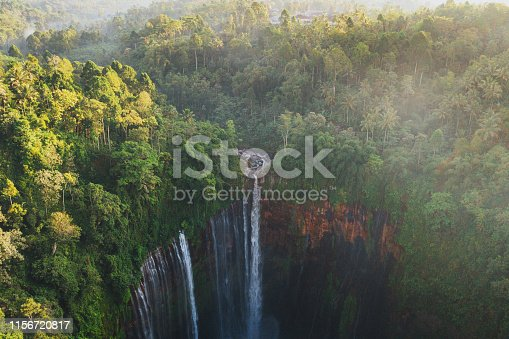 Scenic aerial view of Tumpak Sewu waterfall in the jungles on Java, Indonesia