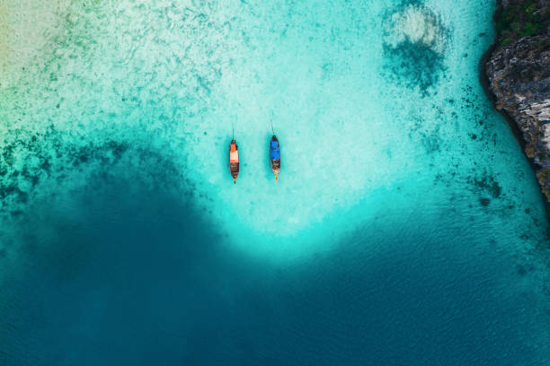 Scenic aerial view of two boats on sea in Thailand stock photo