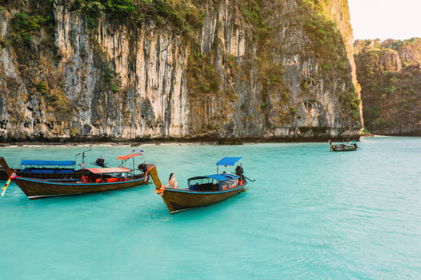 Scenic aerial view of woman on long tail boat near Koh Phi Phi stock photo