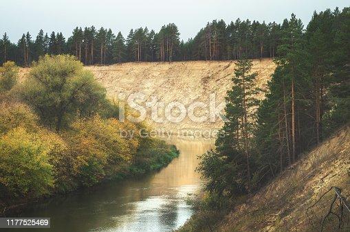 Beautiful scenic autumn winding valley Hoper river. Picturesque nature floodplain sandy cliff edge background