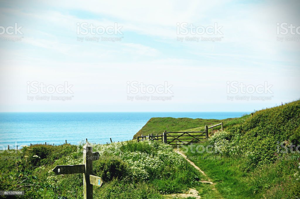 Scenic beautiful cliffs and landscape with sea in background in Cornwall stock photo