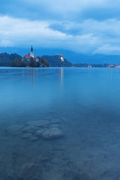 Scenic Bled lake at the twilight with the beautiful island in the background stock photo