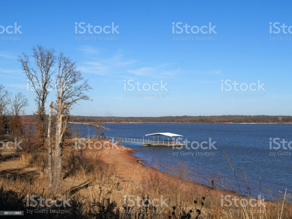 Scenic Blue Waters With A Bridge And Floating Dock Over The Blue