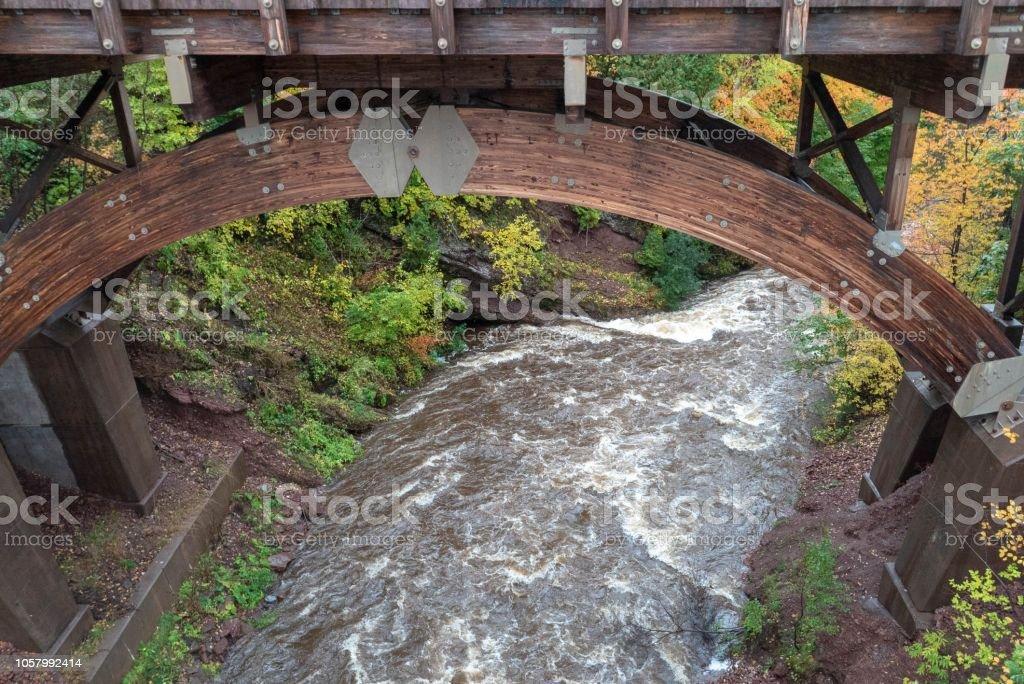 Scenic Bridge at Eagle River Falls in Autumn stock photo