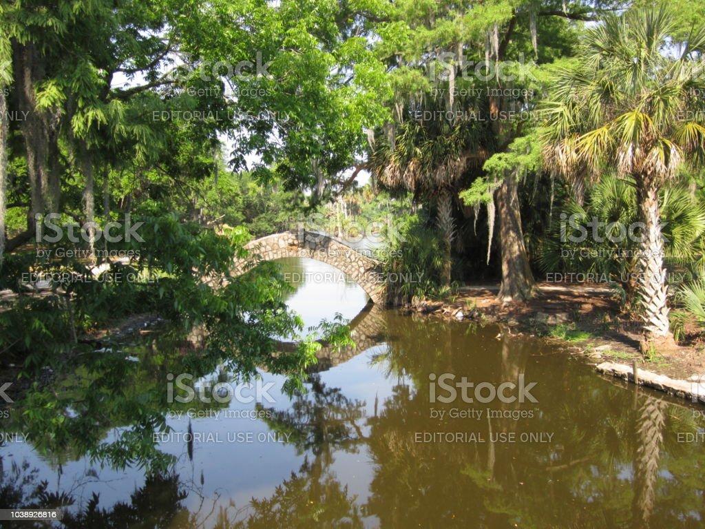 Scenic bridge over water at City Park stock photo
