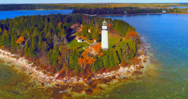 Scenic Cana Island Lighthouse, Door County, Wisconsin, aerial flyby stock photo