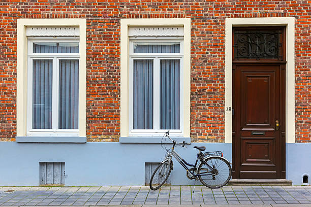 Scenic city view of Bruges street with bike stock photo