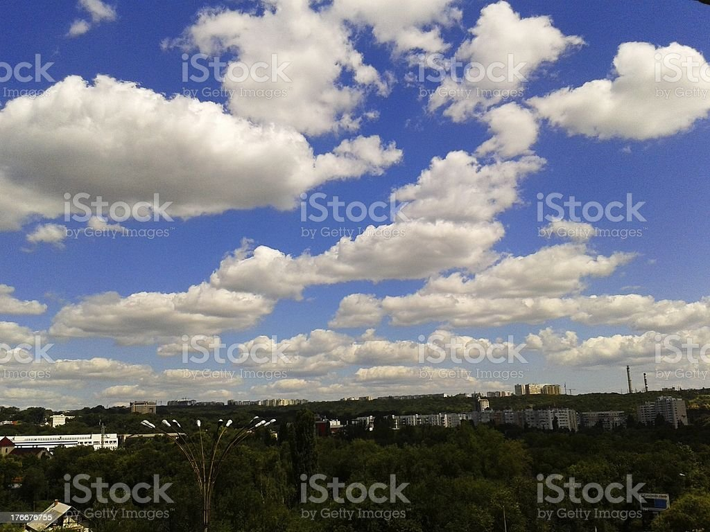 Scenic clouds above a town royalty-free stock photo