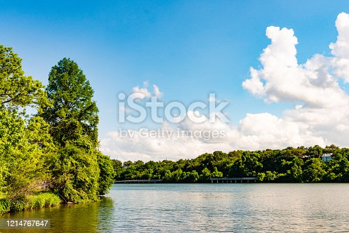 This is a color photograph of a scenic outdoor landscape of the Colorado River in Austin, Texas on a sunny spring day.