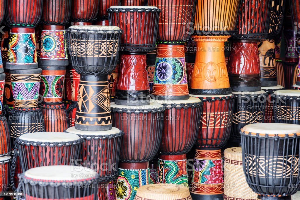 Scenic colorful rows of wooden djembe drums at souvenir shop stock photo