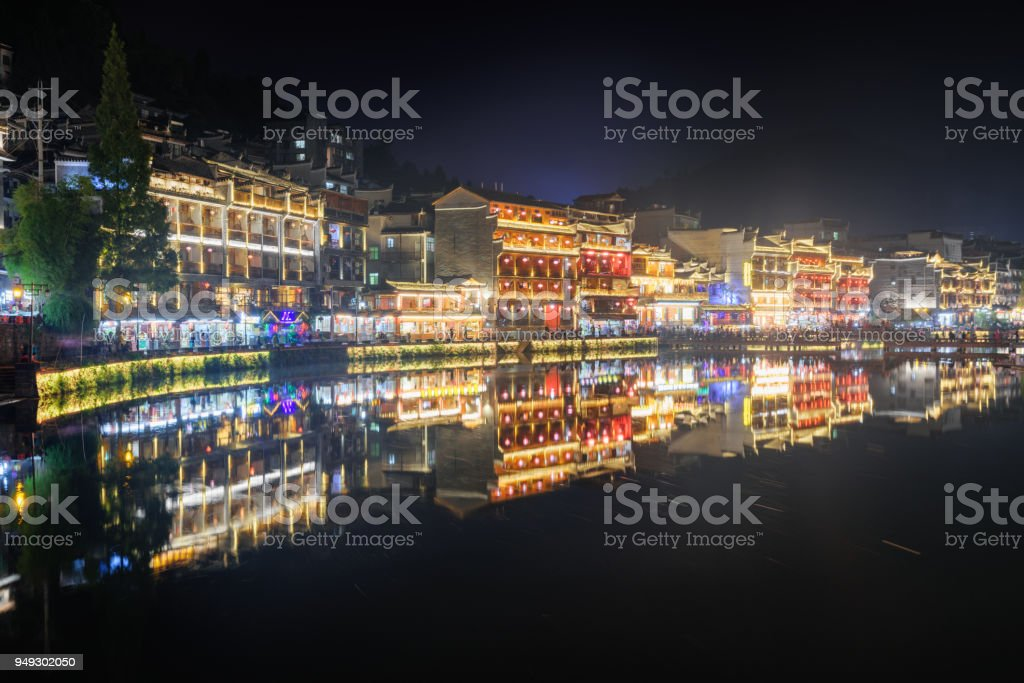 Scenic colorful traditional Chinese buildings reflected in water stock photo