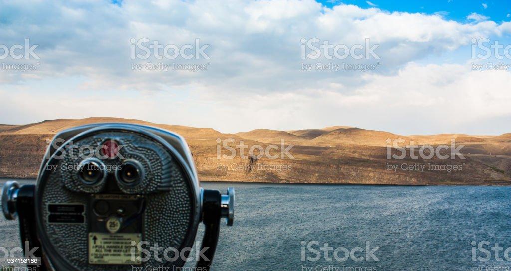 Scenic desert river view showing coin-op binoculars stock photo