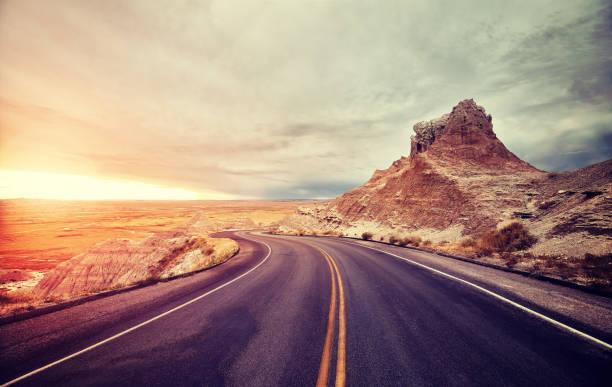 Scenic desert road at sunset, USA. stock photo