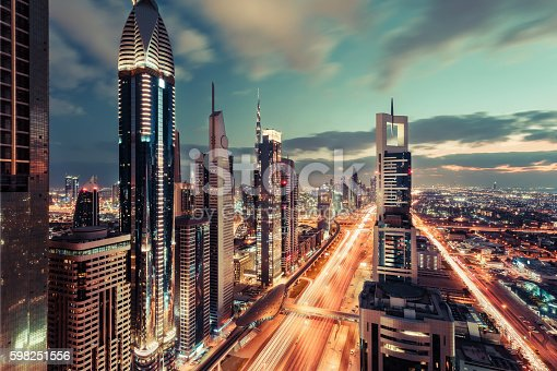 istock Scenic downtown Dubai skyscrapers at night with illuminated road. 598251556