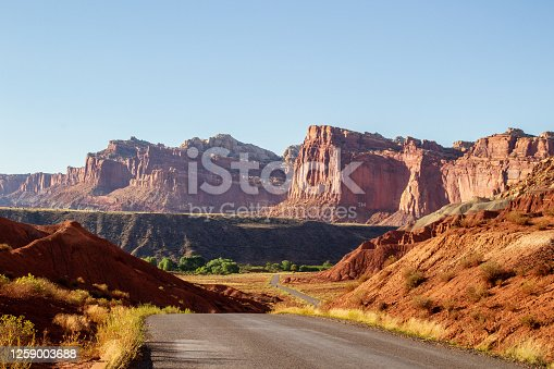 Scenic drive road cuts through the red mountains at Capitol Reef National Park, Utah.