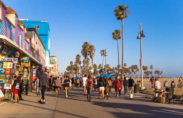 Scenic evening Venice Beach. Los Angeles Tourist Attractions, California Los Angeles, California, USA - June 11, 2017: public beach and rest on Venice Beach, Los Angeles, California, USA. People on vacation. Picturesque coast of the Pacific Ocean and the center of youth culture and recreation. Venice Beach in Los Angeles venice beach stock pictures, royalty-free photos & images
