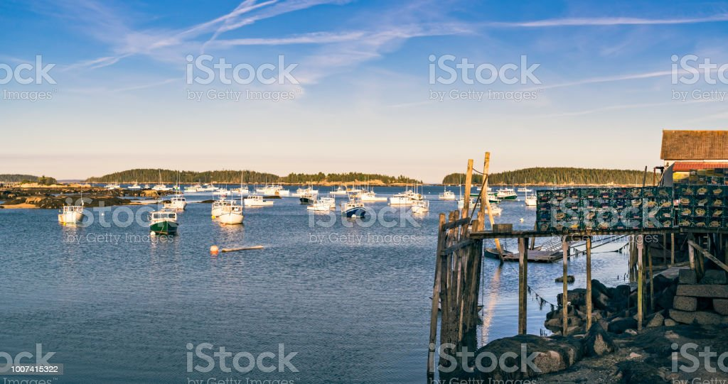 Scenic Fishing Village In Maine With Boats And Lobster Traps Stock