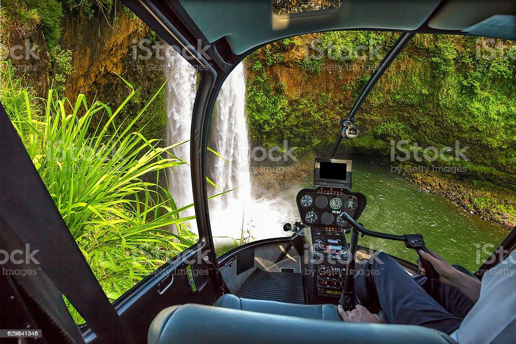 Scenic flight Manawaiopuna Falls stock photo