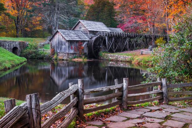 Scenic grist mill, fall foliage stock photo