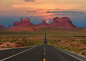 Beautiful scenic highway in Monument Valley Tribal Park in Arizona-Utah border, U.S.A. at sunset