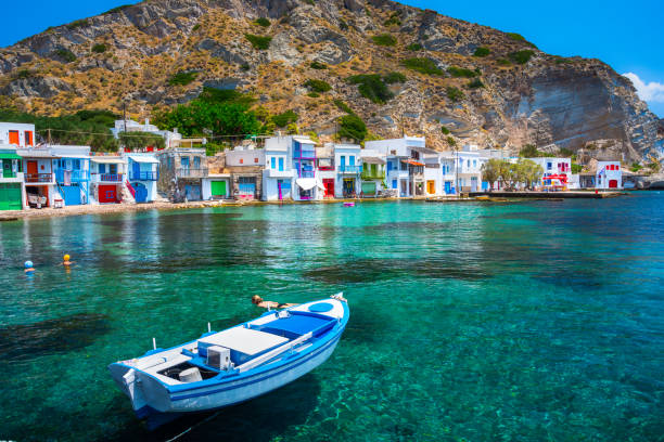 Scenic Klima village (traditional Greek village by the sea, the Cycladic-style) with sirmata - traditional fishermen's houses, Milos island, Cyclades, Greece. stock photo