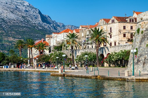 Korcula, Croatia: The island of Korcula with the scenic walled old town known as 'mini-Dubrovnik'. Photo taken during a hot summer day and contains some people.