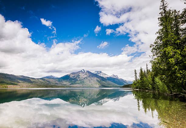 scenic lake mcdonald reflections glacier national park montana - mcdonald lake stock pictures, royalty-free photos & images