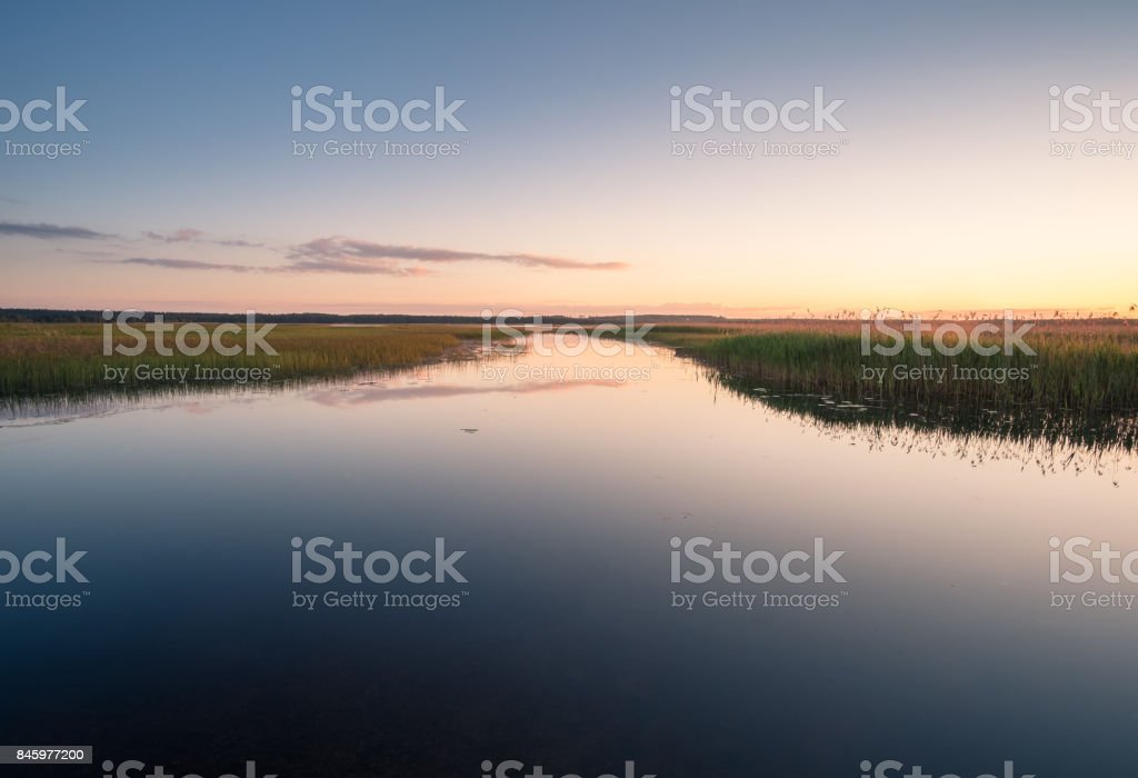 Scenic lake view with peaceful water surface in Finland stock photo