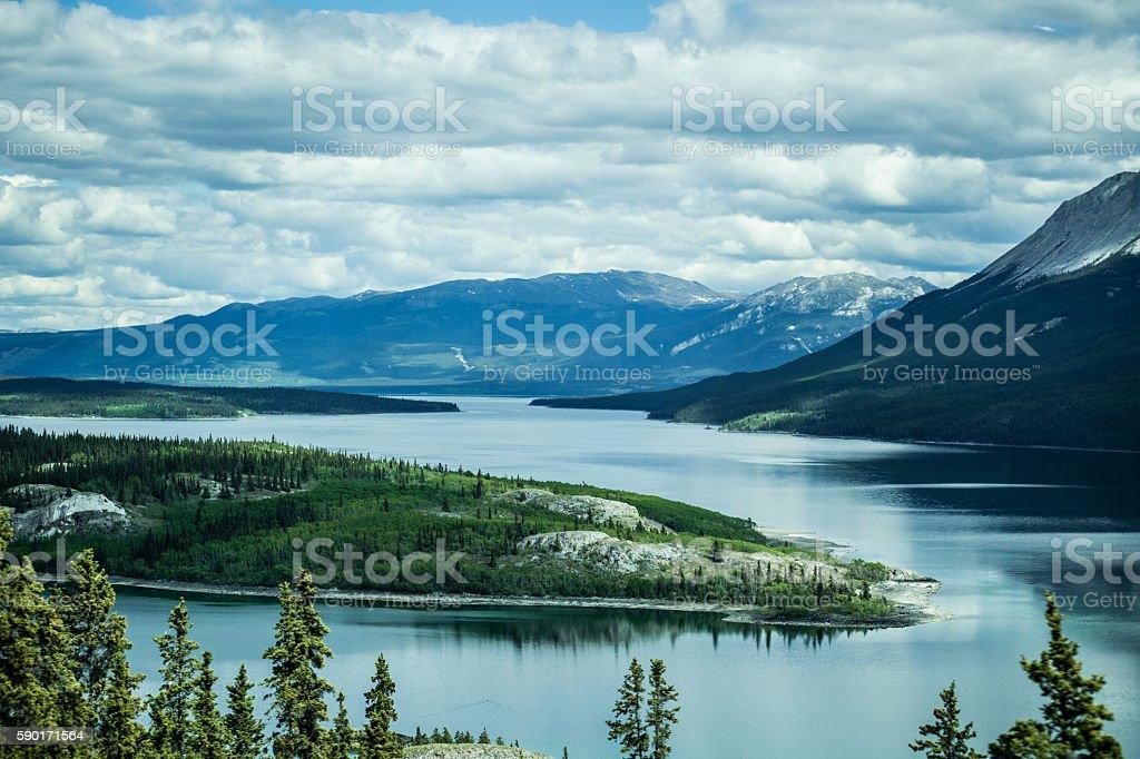 Scenic Lake Winding through Alaska mountains stock photo