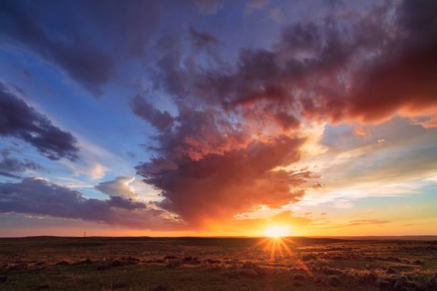 Scenic landscape and sunset sky in Thunder Basin National Grassland, Wyoming stock photo
