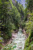 Emerald or turquoise colored water of a river in the gorge \