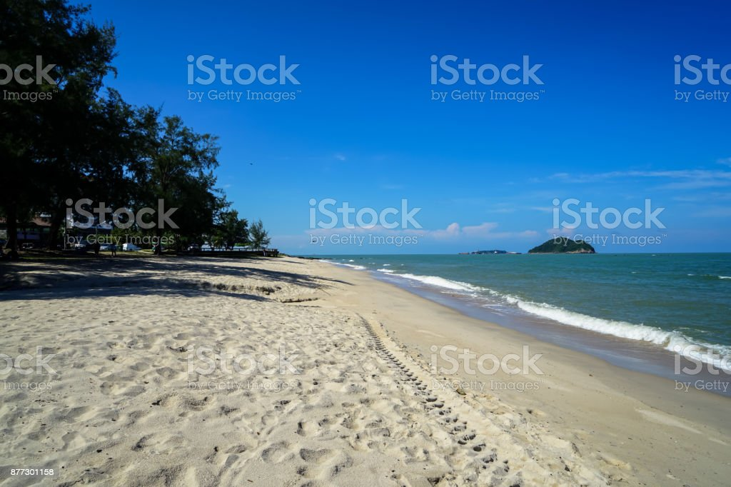 Scenic landscape of calm sea wave on white sandy Sai Kaew beach with small Rat and Cat islands and blue sky background stock photo
