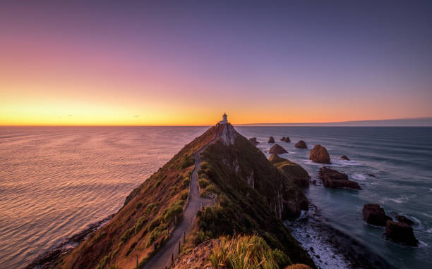 Scenic landscape of Nugget Point lighthouse, Otago, New Zealand stock photo