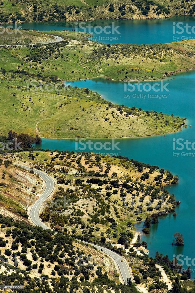 Scenic landscape of rolling hills along Lake Zahara, Andalusia, Spain stock photo