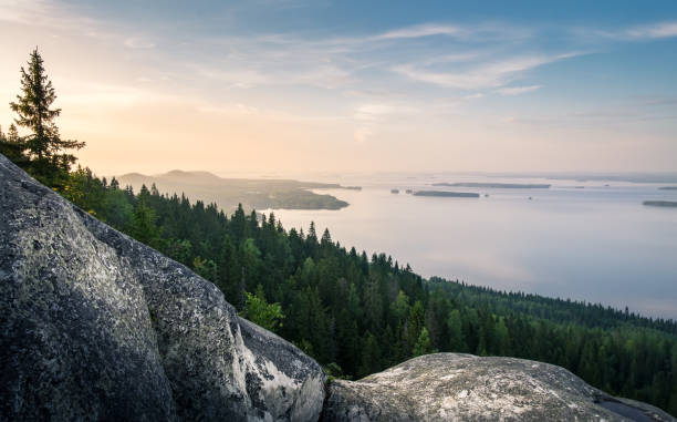 scenic landscape with lake and sunset at evening in koli, national park. - finland stock pictures, royalty-free photos & images