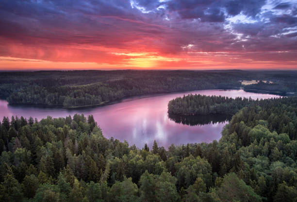 Scenic landscape with sunrise and lake at summer in national park Aulanko, Hämeenlinna, Finland stock photo