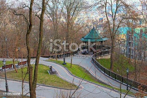 istock Scenic morning view of observation deck with a gazebo in the Saint Volodymyr Hill (Vladimirskaya Gorka) in Kyiv. Picturesque view of Dnipro River and the surrounding area 1213526938
