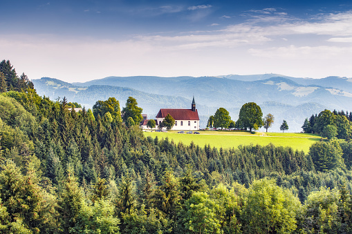 Scenic mountain landscape with an old church in the Black Forest, Germany.