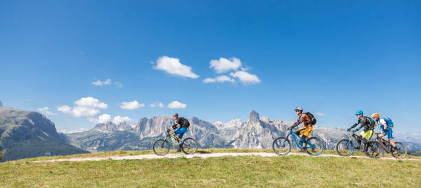 Scenic mountainbiking in the Dolomites, Italy stock photo