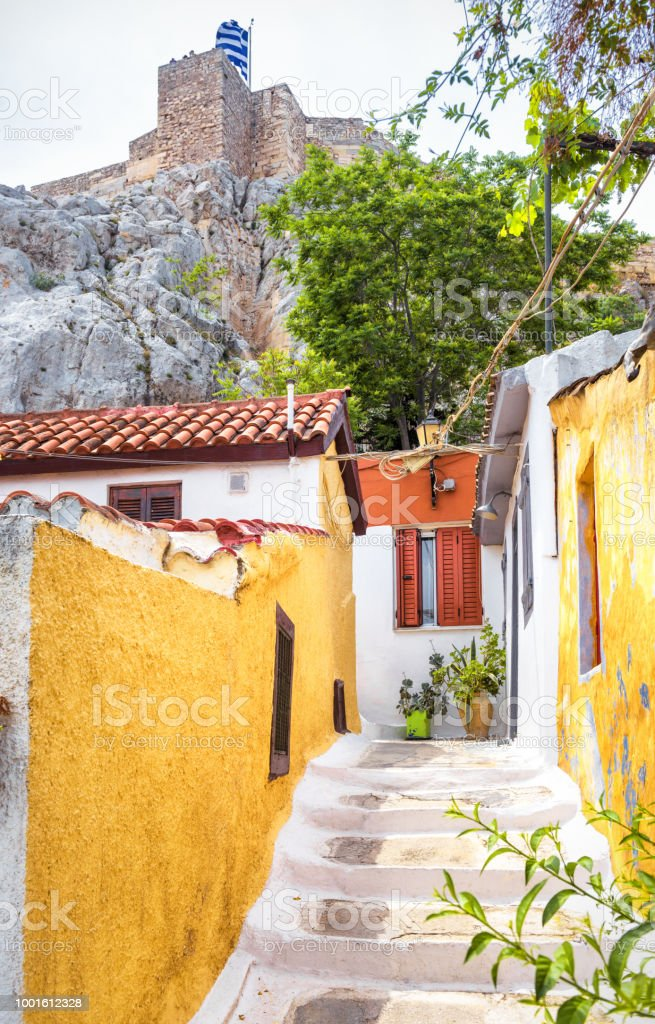 Scenic narrow street with old houses in Anafiotika, Plaka district, Athens, Greece stock photo