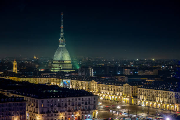 Scenic night cityscape of Turin with the Mole Antonelliana and Vittorio square lighted for the new year celebrations. Italy stock photo