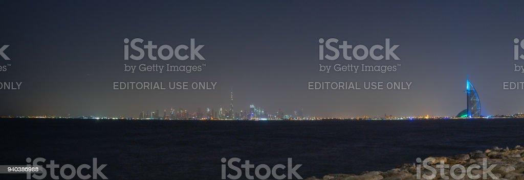 Scenic night Dubai cityscape with Burj Khalifa and Burj al Arab....