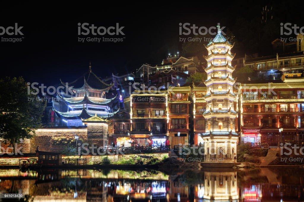 Scenic night view of the Wanming Pagoda, Phoenix Ancient Town stock photo