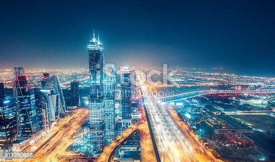 istock Scenic nighttime skyline of big cmodern city with illuminated skyscrapers. Dubai, UAE. 911260658