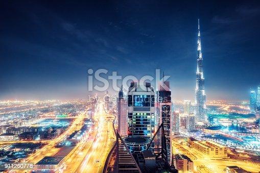 istock Scenic nighttime skyline of big cmodern city with illuminated skyscrapers. Dubai, UAE. 911260778