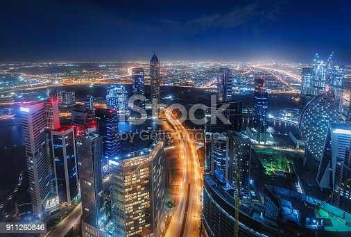 istock Scenic nighttime skyline of big cmodern city with illuminated skyscrapers. Dubai, UAE. 911260846
